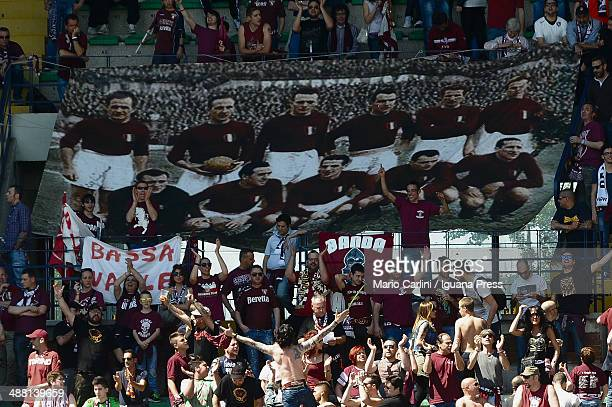 Supporters of Torino FC hold a banners commemorating the Torino players who lost their lives when their plane crashed in what is known as the Superga...
