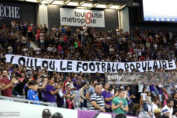 Supporters of Toulouse display a giant banner in memory of Louis Nicolin during the Ligue 1 match between Toulouse FC and Montpellier Herault SC at...