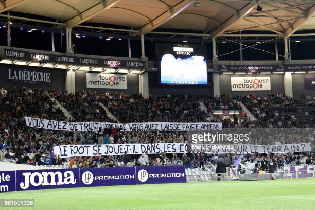 Supporters of Toulouse display giant banners during the Ligue 1 match between Toulouse and Amiens SC at Stadium Municipal on October 14 2017 in...
