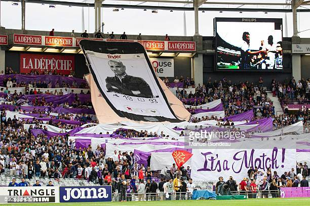 Supporters of Toulouse FC show off a banner honouring Head coach Pascal Dupraz during the Ligue 1 match between Toulouse Fc and Girondins de Bordeaux...