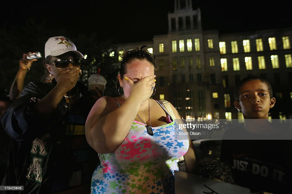 Supporters of Trayvon Martin react in front of the Seminole County Criminal Justice Center after learning George Zimmerman had been found not guilty in Martin's murder on July 13, 2013 in Sanford, Florida. Zimmerman, a neighborhood watch volunteer, shot and killed 17-year-old Martin after an altercation in February 2012.