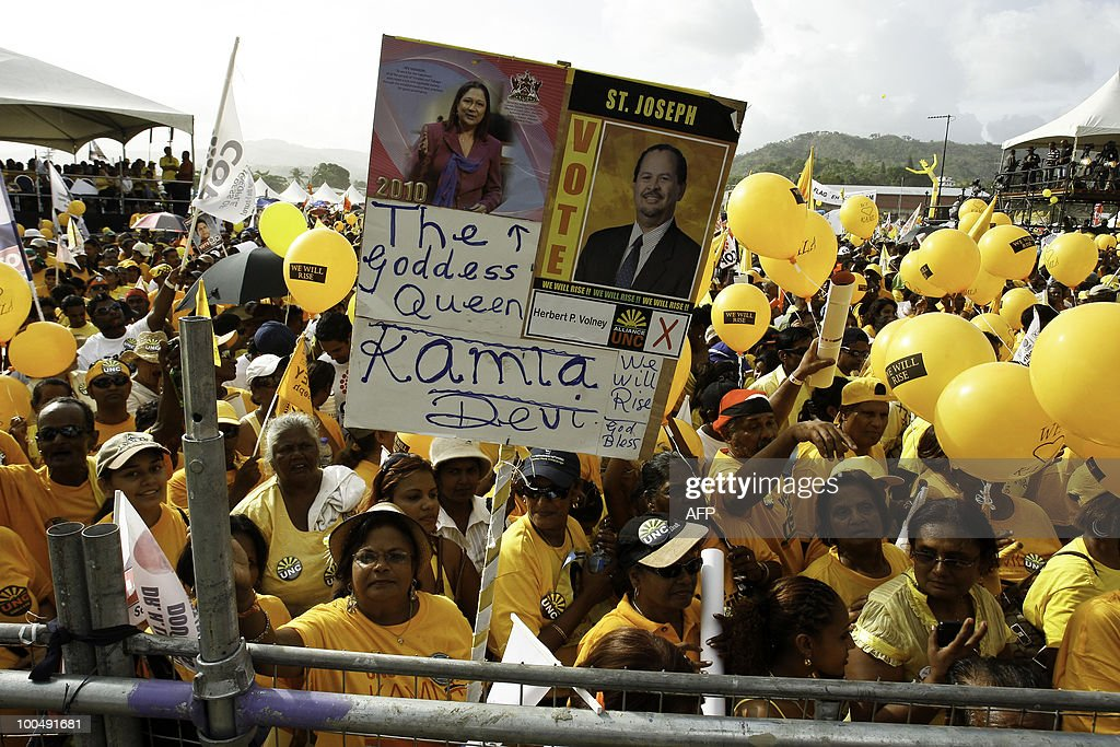 Supporters of Trinidad and Tobago's opposition leader Kamla Persad-Bissessar gather in a rally in Port of Spain, on May 24, 2010 on election day in the twin-island Caribbean nation. Trinidad and Tobago held closely-fought snap elections on Monday, with a former attorney general Persad-Bissessar hoping to become the country's first woman prime minister. Incumbent Patrick Manning called the vote in a risky gamble in the middle of his five-year term in this energy-rich Caribbean nation close to Venezuela's coast. But Persad-Bissessar, who heads a five-party coalition, led late opinion polls after tapping into voters' worries about rising crime and corruption.
