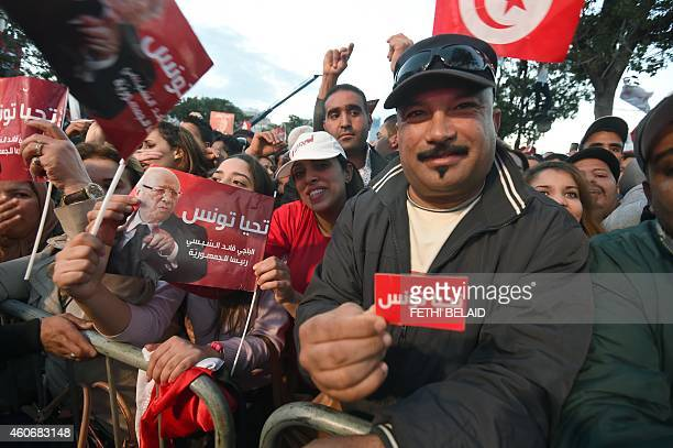 Supporters of Tunisian presidential candidate for the antiIslamist Nidaa Tounes party Beji Caid Essebsi attend his last meeting on December 19 2014...