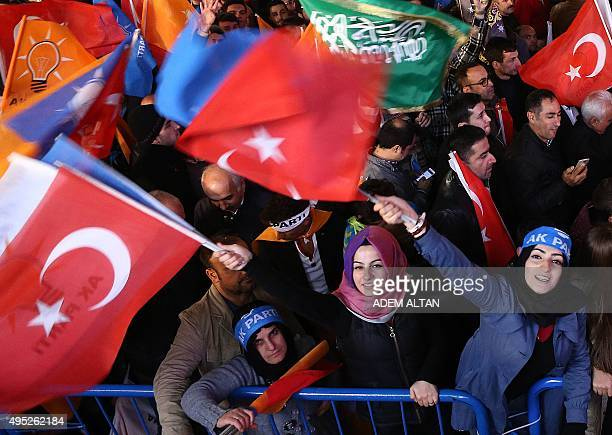 Supporters of Turkey's Justice and Development Party celebrate outside the party's headquarters in Ankara after the first results in the country's...