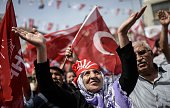 Supporters of Turkey's main opposition party 'Republican People's Party' cheer their leader during an election rally ahead of the legislative...
