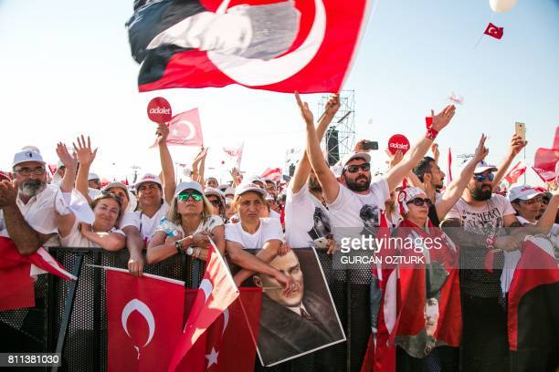 TOPSHOT Supporters of Turkey's main opposition Republican People's Party leader Kemal Kilicdaroglu cheer and wave flags during a rally in Istanbul on...