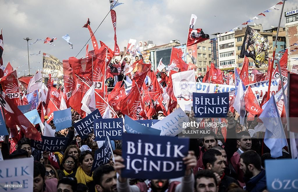 Supporters of Turkey's main opposition Republican People's Party (CHP) wave Turkish and party flags during an election rally at Kadikoy in Istanbul on March 29, 2014. Turkey gears up for local elections on March 30 ahead of a presidential vote in six months and parliamentary polls next year. Turkey's Premier Recep Tayyip Erdogan and his Islamic-leaning party, after over a decade in power, face the first electoral test following months of political turmoil, with mass street protests and a corruption scandal spread via Twitter, Facebook and YouTube. Amid an atmosphere of distrust ahead of tomorow's election with over 50 million eligible voters, the CHP and tens of thousands of citizen volunteers plan to monitor the ballot count.