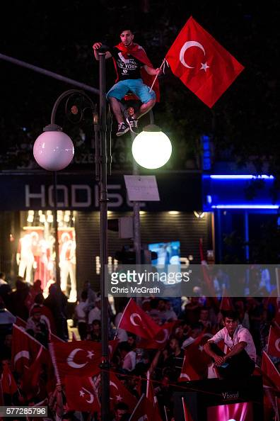 Supporters of Turkish President Recep Tayyip Erdogan attend a rally in Kõzõlay Square on July 18 2016 in Ankara Turkey Clean up operations are...