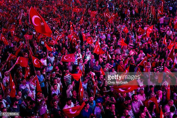 Supporters of Turkish President Recep Tayyip Erdogan attend a rally in Kizilay Square on July 18 2016 in Ankara Turkey Clean up operations are...
