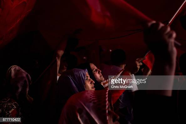 Supporters of Turkish President Recep Tayyip Erdogan attend a rally in Taksim Square on July 19 2016 in Istanbul Turkey Clean up operations are...
