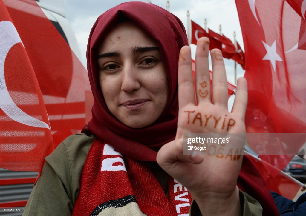 Supporters of Turkish President Recep Tayyip Erdogan await his arrival to Turkey's capital Ankara on April 17, 2017 in Ankara Turkey. Erdogan declared victory in Sunday's historic referendum that will grant sweeping powers to the presidency, hailing the result as a 'historic decision. 51.4 per cent per cent of voters had sided with the 'Yes' campaign, ushering in the most radical change to the country's political system in modern times.Turkey's main opposition calls on top election board to annul the referendum. OSCE observers said that a Turkish electoral board decision to allow as valid ballots that did not bear official stamps undermined important safeguards against fraud.