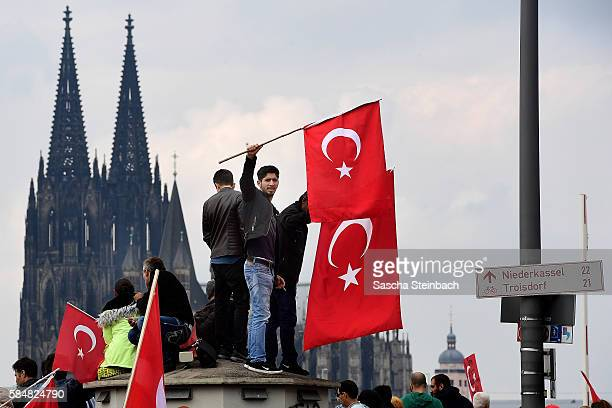 Supporters of Turkish President Recep Tayyip Erdogan rally at a gathering on July 31 2016 in Cologne Germany Cologne and surrounding cities are home...