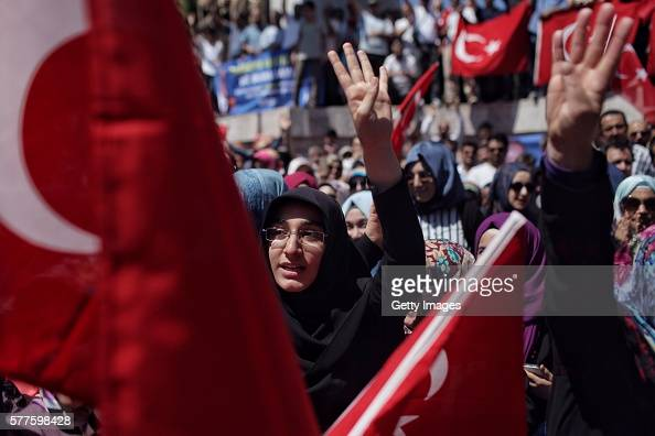 Supporters of Turkish President Recep Tayyip Erdogan wave flags during a rally in Fatih district on July 19 2016 in Istanbul Turkey Clean up...