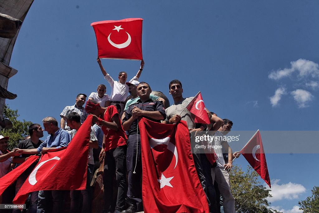 Supporters of Turkish President Recep Tayyip Erdogan wave flags during a rally in Fatih district on July 19, 2016 in Istanbul, Turkey. Clean up operations are continuing in the aftermath of Friday's failed military coup attempt. Latest figures according to Turkey's Prime Minister Binali Yildirim raises the death toll to 232 with 1491 wounded. Continuing raids across the country have seen 9,322 people detained and 316 arrested including high ranking soldiers, judges and police officers.