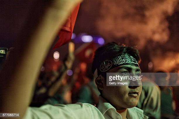 Supporters of Turkish President Tayyip Erdogan gather in Istanbul's central Taksim Square on July 18 2016 in Istanbul Turkey Clean up operations are...