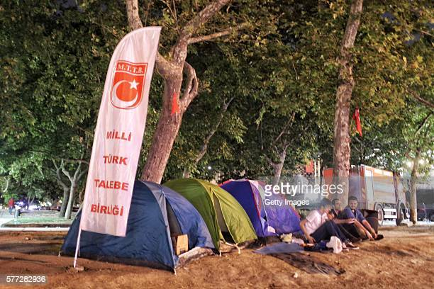 Supporters of Turkish President Tayyip Erdogan sit next to their tents in iconic Gezi Park in Istanbul's Taksim Square on July 18 2016 in Istanbul...