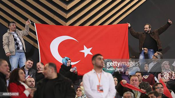 Supporters of Turkish Prime Minister Recep Tayyip Erdogan attend a rally at Tempodrom hall on February 4 2014 in Berlin Germany Turkey will soon face...