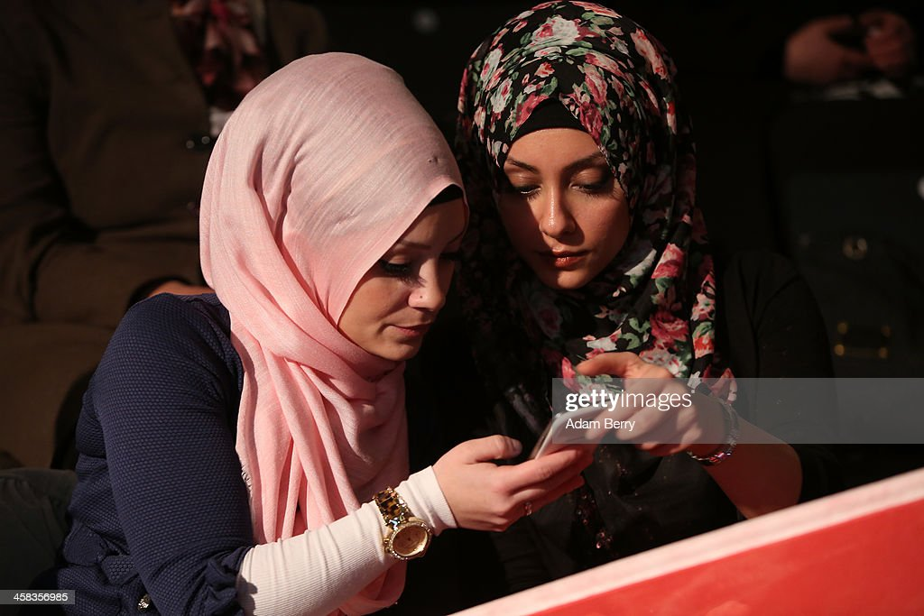 Supporters of Turkish Prime Minister Recep Tayyip Erdogan look at a mobile phone as they attend a rally at Tempodrom hall on February 4, 2014 in Berlin, Germany. Turkey will soon face parliamentary elections and Erdogan is vying for the votes of expatriate Turks. Berlin has the highest Turkish population of any city outside of Turkey.