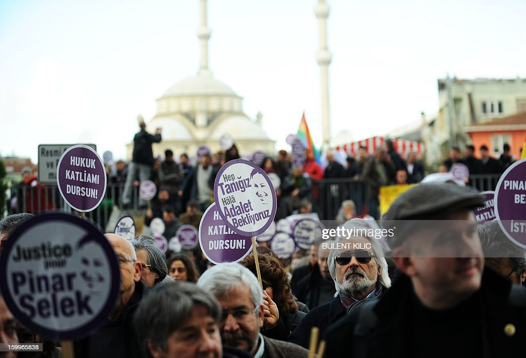 Supporters of Turkish sociologist Pinar Selek demonstrate holding signs reading 'Justice for Pinar Selek' in front of a courthouse in Istanbul on January 24, 2013. Selek is accused of having caused an explosion in Istanbul in 1998. The penal court has already acquitted her on three occasions for lack of evidence but her case will be heard again and the court may issue a fourth verdict. Selek accused since 1998 of terrorism by the Turkish justice for her involvement in the conflict between Kurds and Turks. KILIC