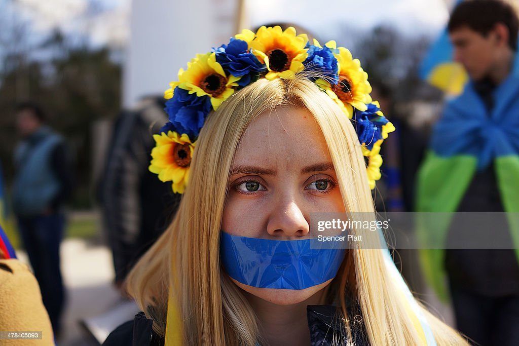 Supporters of Ukraine, some with their mouths taped over, attend a rally in support of the Keeping Crimea a part of the Ukraine on March 13, 2014 in Simferopol, Ukraine. As the standoff between the Russian military and Ukrainian forces continues in Ukraine's Crimean peninsula, world leaders are pushing for a diplomatic solution to the escalating situation. Crimean citizens will vote in a referendum on 16 March on whether to become part of the Russian federation.