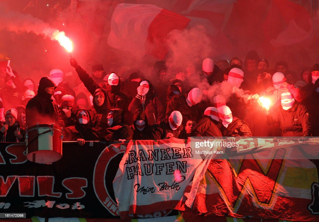 Supporters of Union Berlin with pyrotechnical articles celebrate their team during the Second Bundesliga match between Hertha BSC Berlin and 1.FC Union Berlin at Olympic Stadium on February 11, 2013 in Berlin, Germany.
