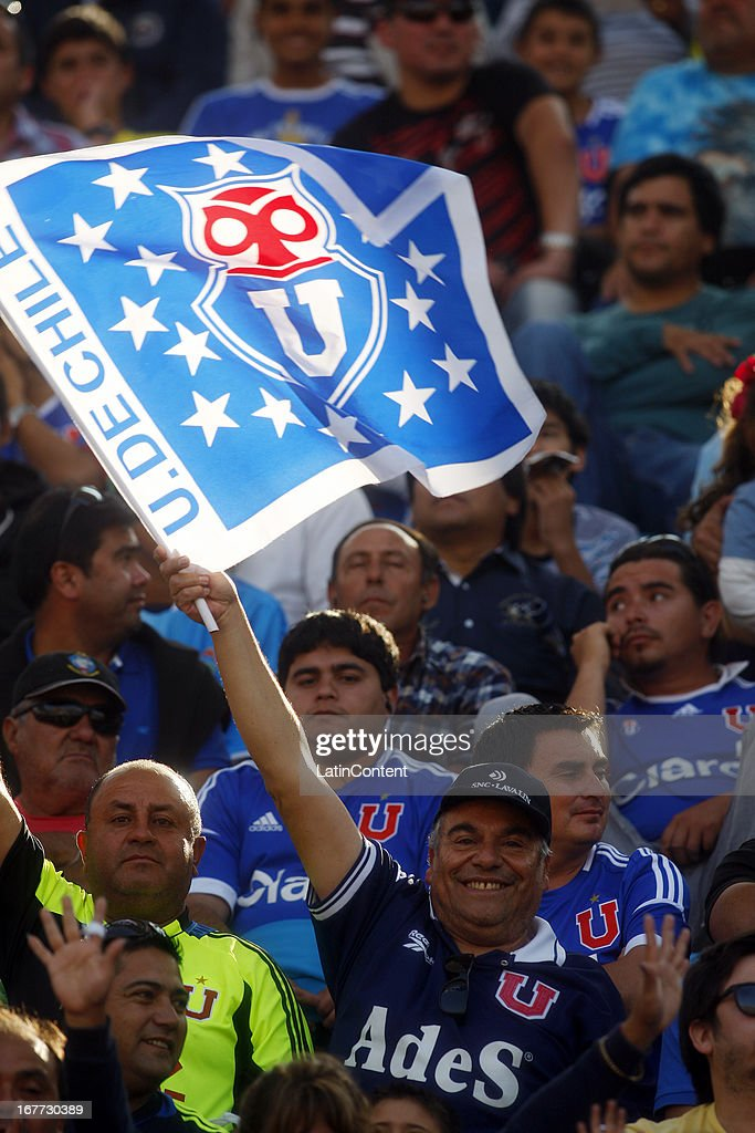 Supporters of Universidad de Chile cheer for their team during a match between Antofagasta and Universidad de Chile as part of Torneo Descentralizado 2013 at Bicentenario Calvo y Bascunan stadium on April 28, 2013 in Antofagasta, Chile.
