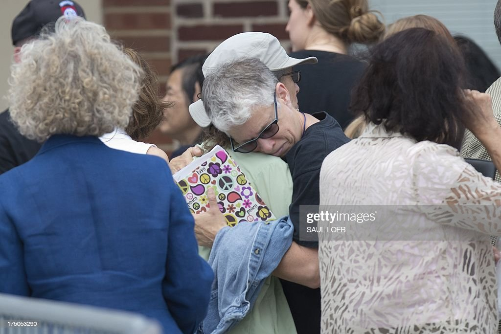 Supporters of US Army Private First Class Bradley Manning hug after attending the trial where Manning was read his verdict in the trial at a military court at Fort Meade, Maryland on July 30, 2013. A US military judge convicted Bradley Manning of espionage Tuesday, leaving him facing a lengthy jail term despite clearing him on the most serious charge that he 'aided the enemy.' Colonel Denise Lind found Manning guilty of 20 of 22 counts related to his leaking of a huge trove of secret US diplomatic cables and military logs to the WikiLeaks website. She said she would begin sentencing hearings on Wednesday, at the Fort Meade military base outside Washington where the trial was held. If Lind decides to impose penalties in the higher ranges permitted under the charges, the now 25-year-old Manning could face a de facto life sentence of more than 100 years in jail. AFP PHOTO / Saul LOEB