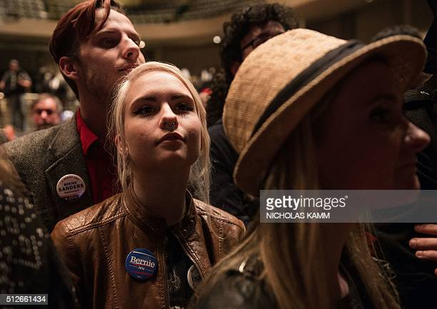 Supporters of US Democratic presidential candidate Bernie Sanders look on before Sanders addresses rally at the Township Auditorium in Columbia South...
