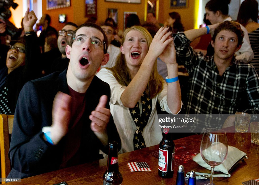 Supporters of U.S. President Barack Obama cheer while watching coverage of the U.S. Presidential Elections on on November 6, 2012 in London, England. U.S. President Barack Obama and Republican presidential candidate Mitt Romney are in a virtual tie in the national polls.