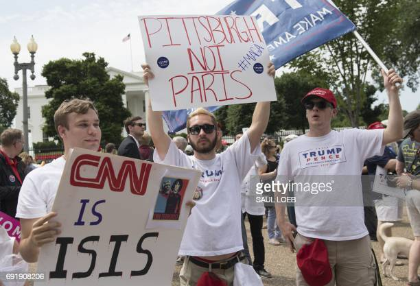 Supporters of US President Donald Trump and his policies demonstrate during a 'Pittsburgh Not Paris' rally in support of his decision to withdraw the...