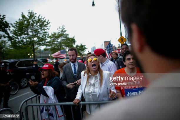 Supporters of US president Donald Trump argue with Activists as they take part in a protest near the USS Intrepid where US president Trump is hosting...