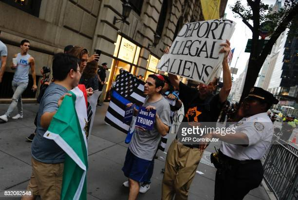 Supporters of US President Donald Trump confront protesters gathered near Trump Tower to demonstrate against attacks on immigrants under the policies...