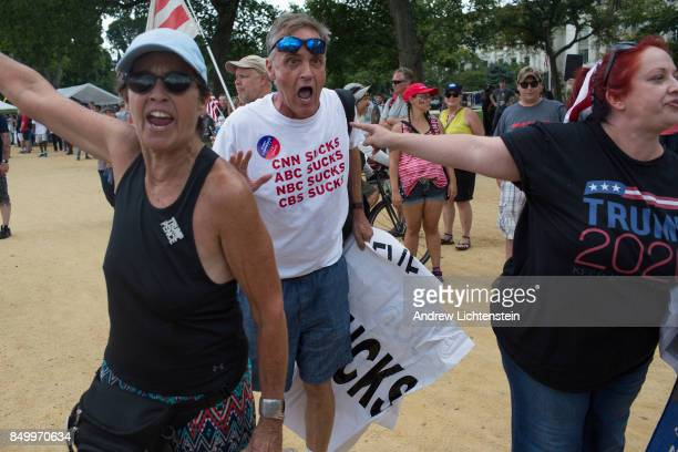 Supporters of US President Donald Trump scream at the media as they gather for what was billed as 'The Mother of all Rallies' on September 16 2017 on...