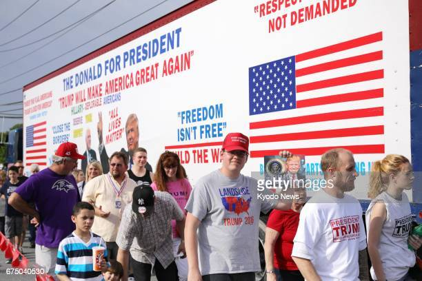 Supporters of US President Donald Trump wait in line for a campaignstyle rally in Harrisburg Pennsylvania on April 29 the 100th day of Trump's...