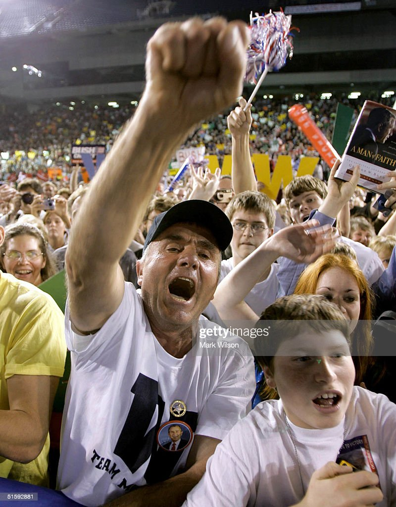Supporters of U.S. President George W. Bush cheer during a campaign rally at the Silverdome, October 27, 2004 in Pontiac, Michigan. Recent polls show that the president is in a neck and neck race his challenger, Democratic presidentail candidate John Kerry (D-MA).