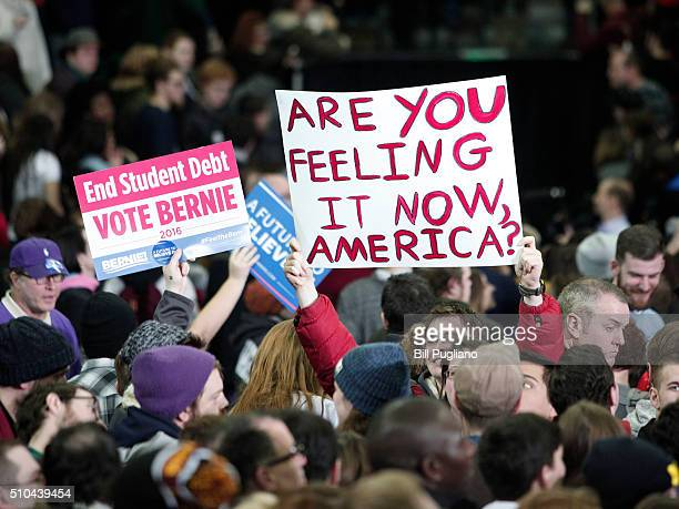 Supporters of US Senator and Democratic Presidential Candidate Bernie Sanders hold signs at Sanders' first campaign rally in Michigan at Eastern...