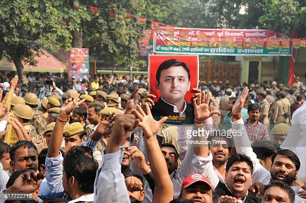 Supporters of Uttar Pradesh Chief Minister Akhilesh Yadav shout slogans outside party office during an internal Samajwadi Party meeting to resolve...