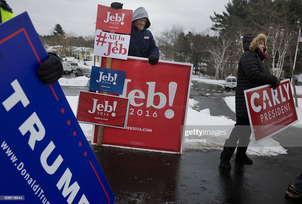 Supporters of various candidates stand outside a polling station at Broken Gound Elementary School in Concord, New Hampshire, U.S., on Tuesday, Feb. 9, 2016. Voters in New Hampshire took to the polls today in the nation's first primary in the U.S. presidential race. Photographer: Victor J. Blue/Bloomberg via Getty Images