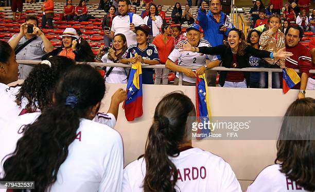 Supporters of Venezuela cheer with the team after the FIFA U17 Women's World Cup 2014 group A match between Venezuela and Zambia at Estadio Nacional...