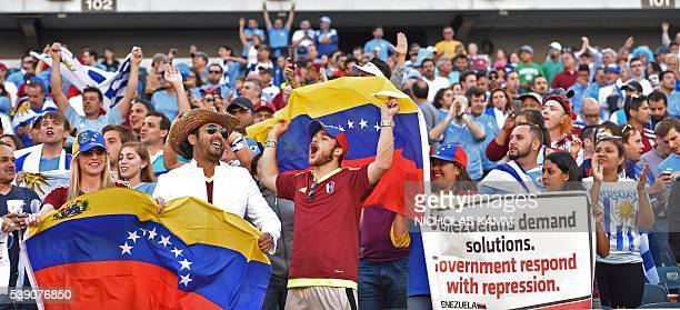 Supporters of Venezuela display a banner against their government as they wait for the start of the Copa America Centenario football tournament match...