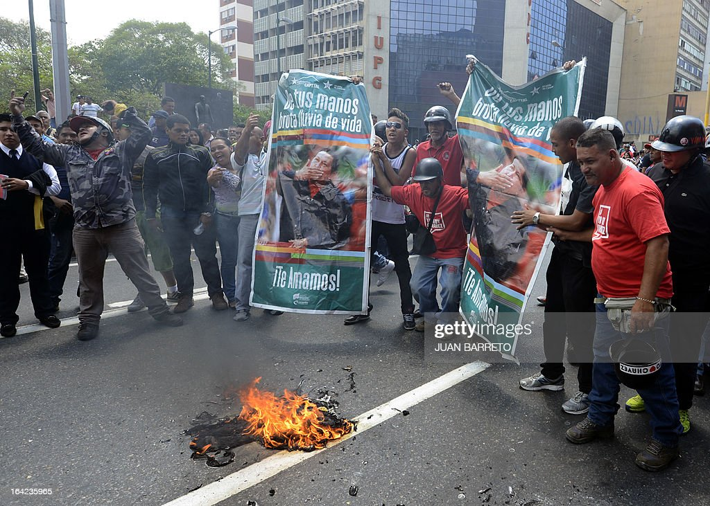 Supporters of Venezuelan acting president Nicolas Maduro shout at opposition students demonstrating in downtown Caracas on March 21, 2013 demanding to the National Electoral Council (CNE) transparency during the presidential elections next February 14.
