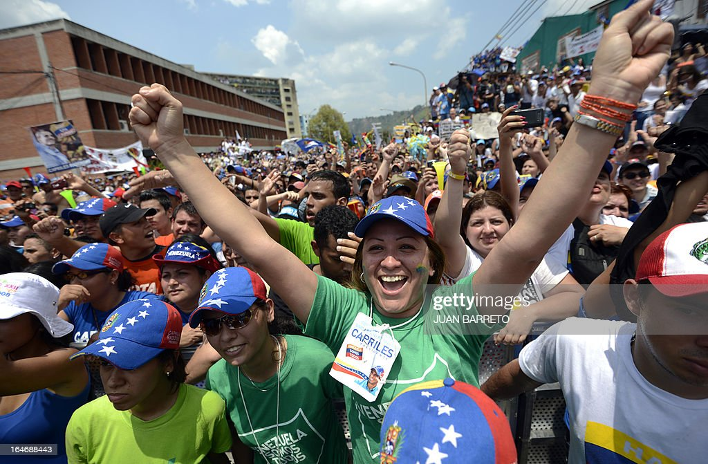 Supporters of Venezuelan opposition presidential candidate Henrique Capriles (not depicted) cheer during a rally in Valera, Trujillo state, Venezuela on March 26, 2013. Venezuela will elect its new president on April 14, 2013. AFP PHOTO