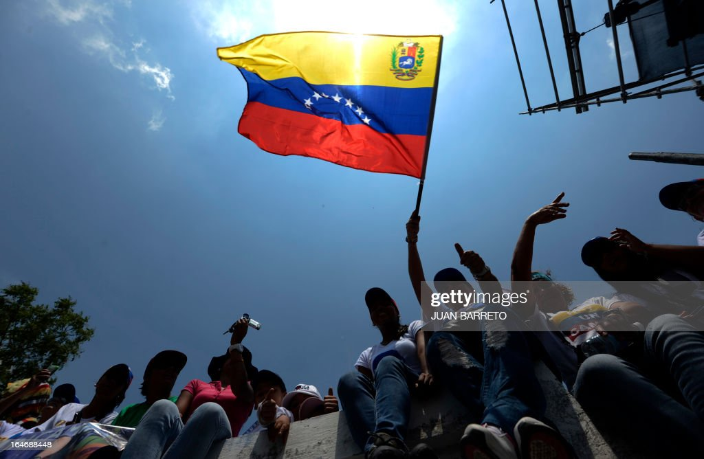 Supporters of Venezuelan opposition presidential candidate Henrique Capriles (not depicted) during a rally in Valera, Trujillo state, Venezuela on March 26, 2013. Venezuela will elect its new president on April 14, 2013. AFP PHOTO/JUAN BARRETO
