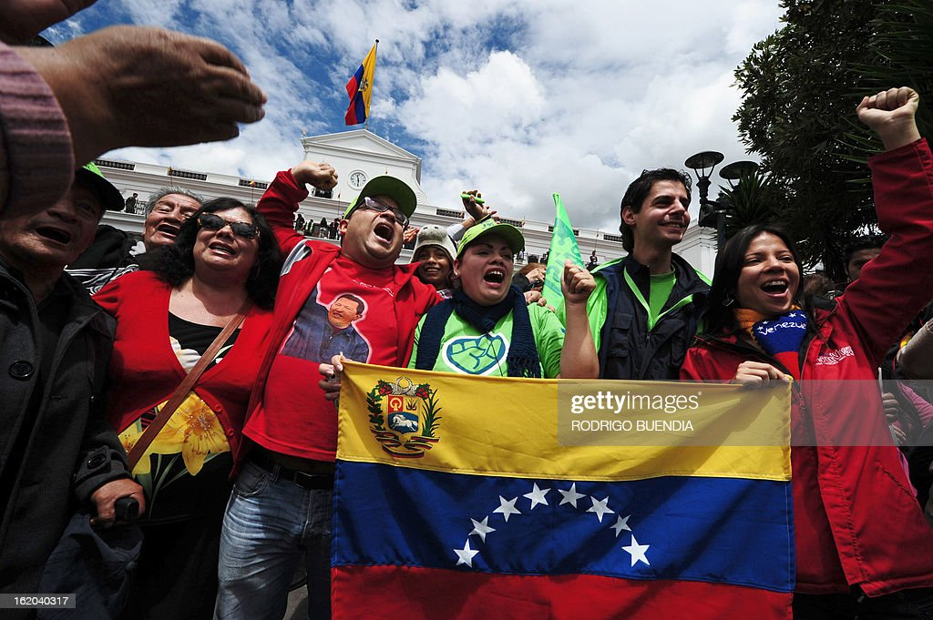 Supporters of Venezuelan President Hugo Chavez and Ecuadorean President Rafael Correa celebrate in front of Carondelet presidential palace in Quito on February 18, 2013 as Correa appears on the balcony of the palace celebrating his reelection. Fresh from a landslide re-election victory, President Rafael Correa hoped Monday to match it with a sweeping legislative win needed to clear the way for deeper socialist changes in Ecuador.