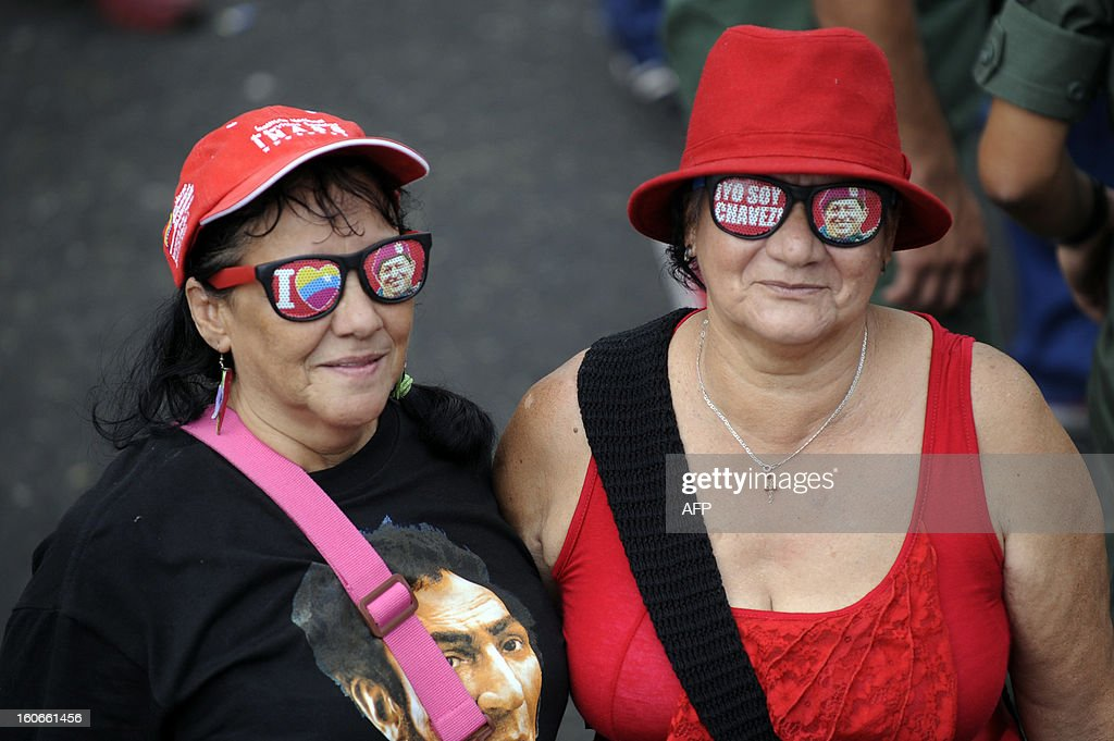 Supporters of Venezuelan President Hugo Chavez attend the conmemoration of the 1992 failed coup led by Chavez, who was an army lieutenant colonel, against then president Carlos Andres Perez, in Caracas, on February 4, 2013. Ailing President Hugo Chavez, who had cancer surgery in December, is doing much better and recovering, Cuban leader Fidel Castro said in remarks published Monday. AFP PHOTO/Leo RAMIREZ AFP PHOTO/ Leo RAMIREZ
