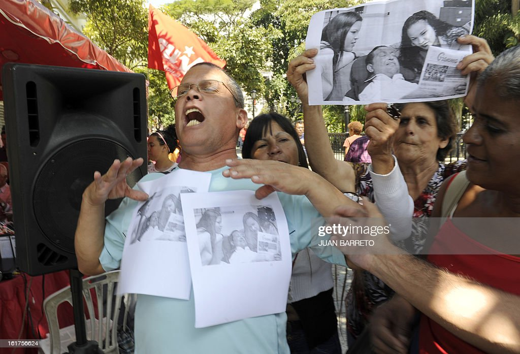 Supporters of Venezuelan President Hugo Chavez celebrate after pictures of the ailing leader surrounded by his daughters in Havana where released to the public, in Caracas on February 15, 2013. Chavez was seen bed-ridden but smiling in photos released Friday that gave a jittery nation a first glimpse of him since his fourth round of cancer surgery in December. The total of four images -- of Chavez holding Thursday's edition of the official Cuban communist party newspaper Granma -- broke a virtual news blackout for Venezuelans living in a state of limbo without their once media-happy and larger than life comandante.