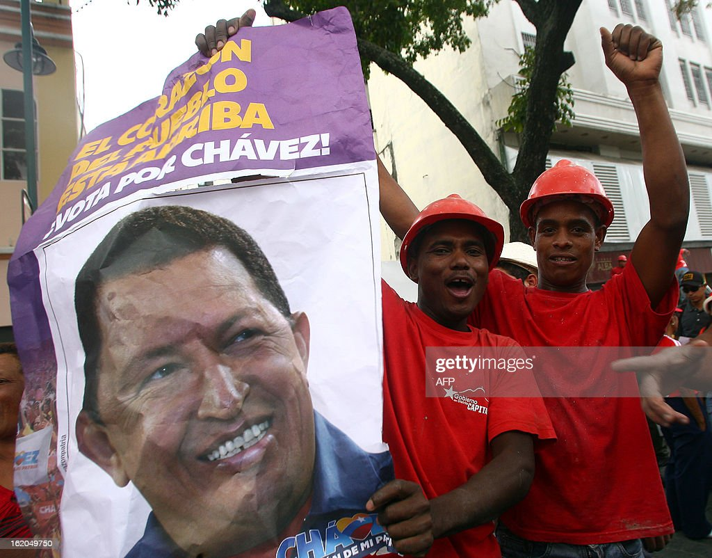 Supporters of Venezuelan President Hugo Chavez celebrate at Simon Bolivar Square in Caracas, following his return from Cuba on February 18, 2013. Chavez returned to Venezuela early on Monday after spending more than two months in Cuba for cancer surgery and treatment, announcing his surprise homecoming via Twitter. 'We have arrived again to the Venezuelan motherland,' Chavez wrote. 'Thank you, God. Thank you, my beloved people. We will continue my treatment here.'