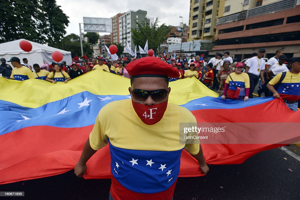 Supporters of Venezuelan President Hugo Chavez celebrate the 11th anniversary of a failed coup that Chavez commanded in 1992, on February 04, 2013 in Caracas, Venezuela. This event catapulted him to win the presidency in 1998 and begin the Bolivarian Revolution. President Chavez still remains hospitalized in Havana .