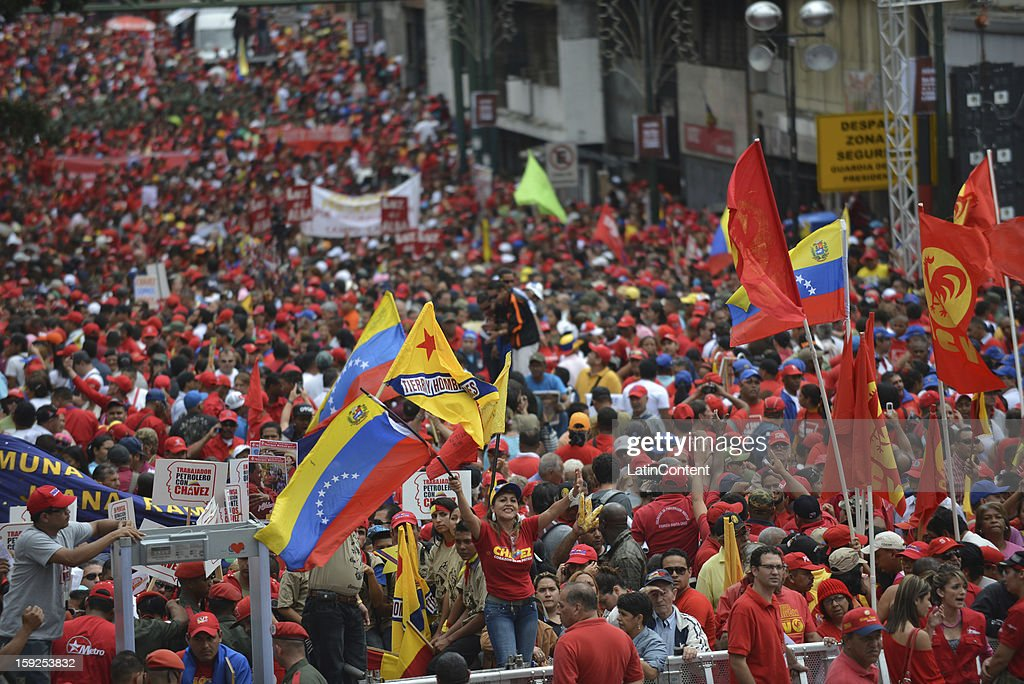 Supporters of Venezuelan President Hugo Chavez gather around Miraflores Presidential Palace on January 10, 2013 in Caracas, Venzuela. Chavez is now hospitalized in Cuba due to a cancer. Meanwhile, his followers back him up in the day a new presidential term is inaugurated without him. People make their way to Miraflores Presidential Palace to witness a symbolic swearing-in.