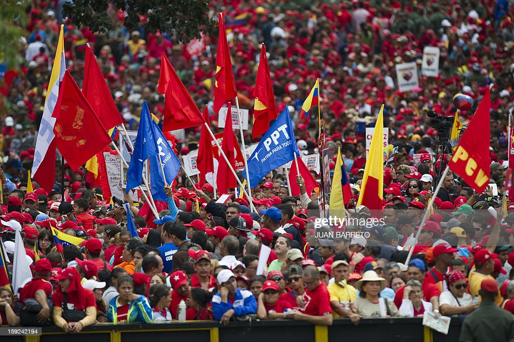 Supporters of Venezuelan President Hugo Chavez gather outside Miraflores presidential palace during an event in homage of Chavez, in Caracas on January 10, 2013. With Chavez ailing and absent, Venezuela's leftist government launches a new presidential term with a display of popular support on the day he was to be inaugurated. The Supreme Court cleared the cancer-stricken president,kwho is recovering from a fourth round of cancer surgery in Havana, to indefinitely postpone his re-inauguration and said his existing administration could remain in office until he is well enough to take the oath. The government has said that he is recovering from complications from surgery, most recently a severe pulmonary infection that had resulted in a 'respiratory insufficiency.'